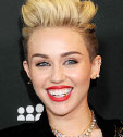 Miley Cyrus grows her hair with taking Viviscal every night